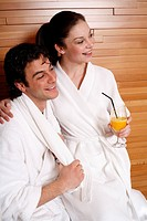 A couple having a refreshment after a spa treatment