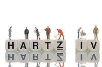 Various figures standing on the words Hartz IV