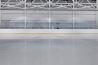 A large sporting venue interior, an ice rink, rink, for skating events. Ice surface. Marked up areas for sports such as ice hockey and skating competi...