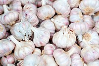 A pile of garlic bulbs at a market