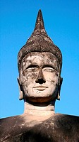 Historic buddha statues against blue sky in the Laos