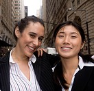 Multi_ethnic business women and best friends pose outside in an urban environment