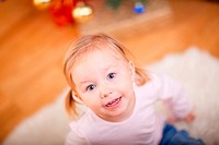 Indoor portrait of adorable playful 2 years old girl