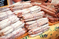 Different sorts of sausages at a market