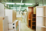 A small woodworking factory, or cabinet making workshop. A building full of wooden furniture. Shelves, cupboards. Light manufacturing, and skilled car...
