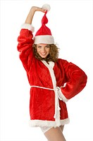 girl in santa claus dress pulling her hat and smiling