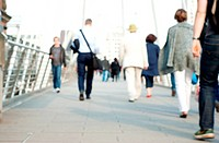Defocussed Commuters crossing bridge in London Purposely out of focus