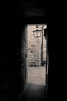 pathway or walkway through urban buildings.old urban structure in brick with lamp