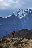 photographer in Nepal looking at Kongde Ri mountain