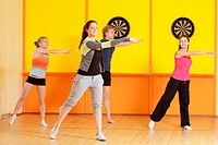 Group makes left turn at aerobics training in gym