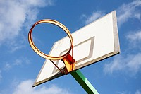 basketball hoop against a blue sky and white clouds