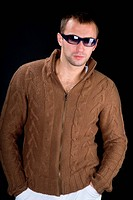 Young man wearing sunglasses on a black background