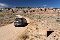 Car on a dirt road, Notom-Bullfrog Road, Capitol Reef National Park, Strike Valley and Waterpocket Fold, Utah, USA
