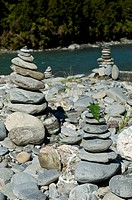 Cairns or Stacks of Rocks near a Riverside