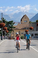 Couple riding electric bicycles in Bolzano, province of Bolzano-Bozen, Italy, Europe