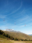 Empty ski lifts during the summer with pyrenees mountains in the background
