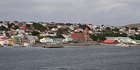 Falkland Islands, South Atlantic, Stanley Harbour. Town of Port Stanley and pier, seen from the water. Credit as: Bill Young / Jaynes Gallery / Danita...