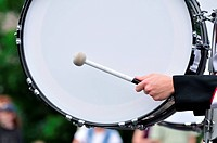 Drummer Playing A Bass Drum in Parade