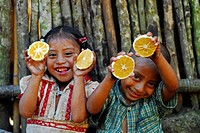 Guatemala, Tuticopote La Laguna, children Maria Soledad Perez, 5, Christopher Alexander Perez, 5 eating five meals in one day, oranges MR