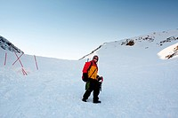 A female mountaineer on a snow filled slope, Svalbard, Norway
