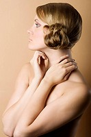 ome side portrait of a pretty blond girl with hair style and light make up over color background