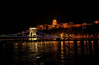 budapest hungary capital building and chain bridge at night from danube river