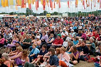 Crowd listening to band of musicians playing on stage at the WOMAD World of Music, Arts and Dance Festival in reading, 2005,
