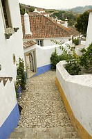 Narrow village streets of Obidos founded by the Celts in 300 BC, Portugal