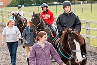 People with visual impairments having riding lessons