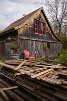 Old wooden barn in a residential backyard garden in autumn, Quebec, Canada