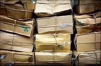 many cardboard boxes stacked,