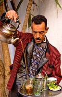 Man Pouring Tea For Sale In Medina Area Of Tunis, Tunisia