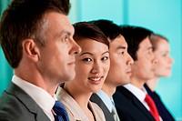 Multi racial businesspeople in a line, portrait