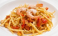 dish of pasta with a tomatoe shrimp sauce