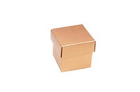 A small gold colored gift box on white background, with copy space.