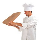 cook with boxes of pizza
