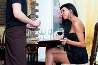 Beautiful woman making the order in restaurant