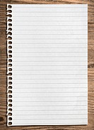 Notebook paper sheet on a wooden table, clipping paht