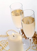 Two champagne glasses on the grey background