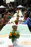 People enjoying ´Feast on the Bridge´ at tables on Southwark Bridge London England during the Thames Festival 2011