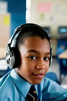 Secondary school student learning languages using headphones,