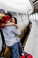 Couple Greeting at Train Station