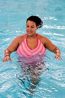 Pregnant woman taking part in an Aquanatal class