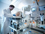 Scientist using equipment in lab