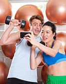 Couple taking picture together in gym