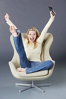 Happy Young Woman in an Arm Chair