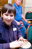 Visually impaired woman playing the drum during a drumming workshop at the NRSB activity day at their centre on Ortzen Street, This is part of the IMP...