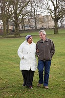 Couple walking in park Cleared for Mental Health issues