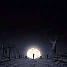 Conceptual image of girl at night silhouetted by the moon at the end of post and rail fencing
