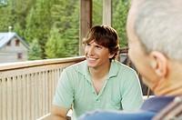 Men sitting on porch